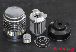 Here's a look at the major components of an S4 C filter, a chrome billet housing, stainless steel filter element, cup wrench and shouldered thread adapter (used in some applications)