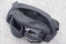 The fanny pack offers room enough for a myriad of camping goodies as well as provisions for a beverage container.