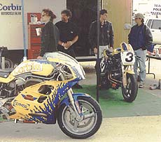 Members of Team Corbin Motorcycle Online discuss strategy before the second round of NASB's 1997 Buell Lightning series. Higbee won by 16 seconds.