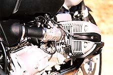 Fuel injection feeds horizontally-opposed cylinders featuring added displacement.