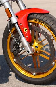 This wheel tire/assembly, complete with Buell's Zero Torsional Load brake, is really really light. Simplify...