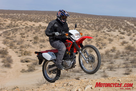 As you'd expect from an air-cooled, two-valve Thumper, arm-yanking power isn't the CRF's bag of tricks.