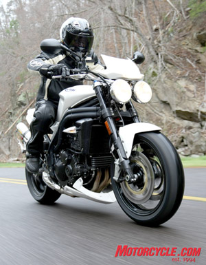 With its distinctive twin round headlamps, the Speed Triple retains its iconic streetfighter persona.