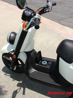 Between your feet is the locking gas cap.