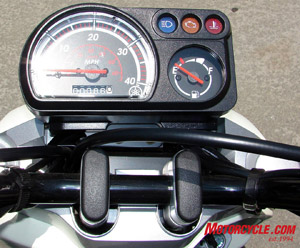 Very basic gauges. Speedometer (tops out at 40), fuel, high beams, check engine and check temperature.
