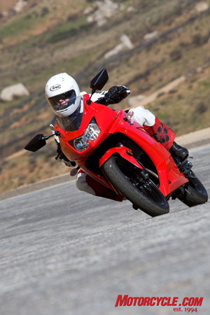 Kawasaki Ninja 250r Red And Black. The quarter-liter Ninja turns