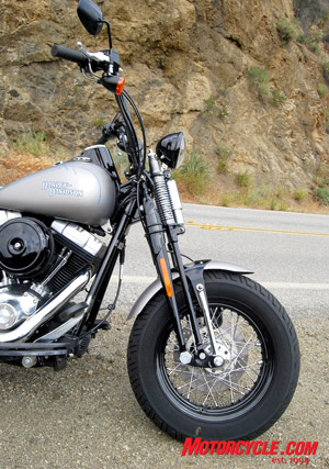 A chopped front fender keeps the eye focused on the fatty front rubber and springer suspension.