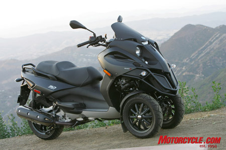 The Piaggio MP3 500's styling is a cross between a grasshopper and a Transformer.