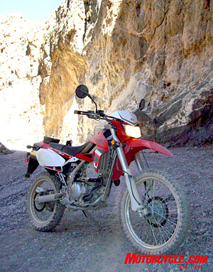"""Nimble, go-anywhere,"" says Kawi. From urban canyon walls to the eroded earthen passages, the '09 KLX passes the test for commuters as well as recreationalists."