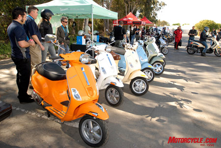 Like a bag of Skittles spilled on the ground, Vespas come in a myriad of colors.