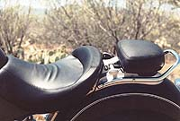 BMW gave the R1200C a leather seat and handgrips. The passenger seat folds up to be used as a backrest.