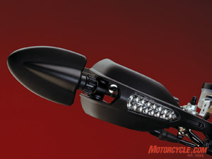 Clever stuff: Bar-end mirrors that pivot inward; hand-guards that feature integral LED turnsignals.