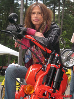 Steven Tyler poses on the hot-rod Dirico Speedster. Photo by the author.