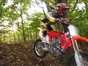 In the woods the instant throttle response of the CRF450 can simply be too much, too soon.