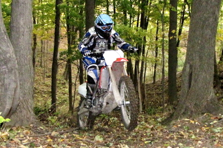 Sometimes a good bike is a good bike, no matter where you ride it. The CRF250R rages in the woods right out of the box. With a few simple mods it would make an excellent hare scramble machine!