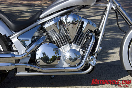 A new fuel-injection system resides between the faux-air-cooled cylinders. Popping off the chromed plastic panel behind the rear cylinder unveils the shock�s adjustment knobs.