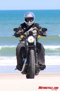 Like a phoenix rising from the south, Fonzie trades in the KLR for a Dark Custom and hits the strand looking for babes. (Sorry, Fonz, I don�t see any girls in this picture. � Ed)