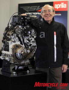 Claudio Lombardi stands next to his masterpiece.