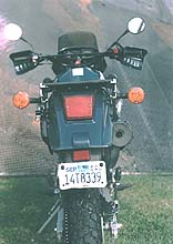 The KLR650's is svelte and tidy for a 337 pounder (dry). The turn signals and taillight are well sized and quite visible. The rear Dunlop 130/80-17 sports a street-biased semi-knobbed pattern. It is perfect for rain and fairly grippy on the street. Those seeking the kind of adventure that involves dirt or sand or mud might want to upgrade to a more burly tread pattern.