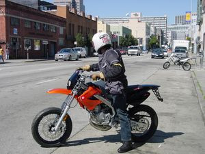 With great brakes and suspension and adequate power, a Super Motard is a great way to get around a crowded city.