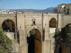 This bridge connects the two halves of Ronda which are split by the 330' deep El Tajo gorge... Probably NOT a good place for a highside.