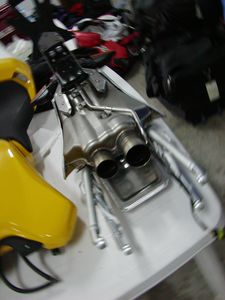 Here's an example of modular design: The whole subframe/muffler is one chunk.