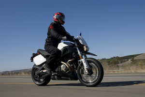 The journalist riding this Buell is more than moderately attractive.