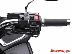 A cluster of switches on the right handlebar controls the LCD display and cruise control.