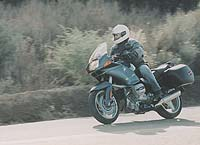 We loved the R1100RS as a long distance sport-touring mount. But in the canyons it felt a little porky.