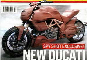 This image, scanned from England�s Motor Cycle News, reveals two key ingredients of the Mega Monster: side-mount radiators and a horizontal rear shock.