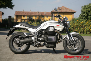 Although based on Guzzi�s old 90-degree V-Twin, this 8-valve new motor shares few parts. Note the large header pipes and side-mounted oil cooler.