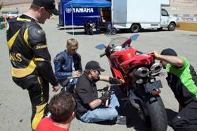 How many men does it take to adjust a Ducati�s suspension? Well, just one, really. Race Tech�s Paul Thede, the guy with Paul Teutul�s favorite tool, is all anyone needs.