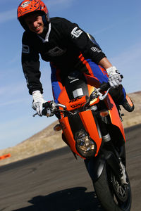 This is what a professional rider on a closed circuit really looks like. KTM stunt rider Oliver Ronzheimer shows off.