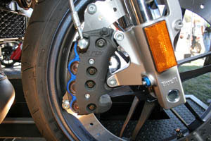 Buell is the only major manufacturer to use a rim-mount perimeter brake rotor. The 1125R uses a single 8-piston brake caliper, the first in production streetbike history, on the 375mm disc. Buell says it's 6 pounds lighter than a twin-disc setup.