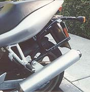Hard luggage attachment system. Note exhaust relocation bracket
