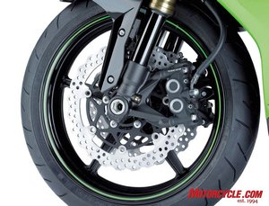 New calipers utilize different sized pistons for improved feel at the lever, and pinch slightly thinner petal rotors. This should be a welcome change from last year's ZX-10R, as its brakes had a spongy feel, especially compared to the brakes on the 10R's competition.
