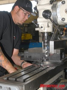 Machining operations are performed with both CNC machines and manually operated machines. Here a worker copes the end of a 0.250-inch wall thickness backbone tubing.
