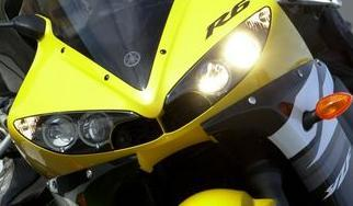"The tricky ""Gatling-beam"" headlight (the marketing guys must still be chuckling to themselves) in fact uses only two bulbs; left side is low beam, both are on for high."