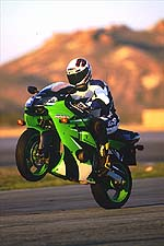 Nigel doesn't like to wheelie. The ZX-6R does. Nigel learned to adapt.