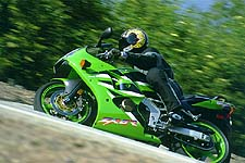 The Kawasaki has decent low-to-mid power, but screams up top. The motor's smooth and has a better tranny than the VFR, but requires more work to ride fast.