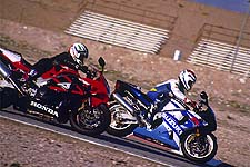 Not an uncommon sight at the track: The Suzuki out in front of the mellower Honda. On the street, however,