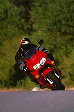 An increase in the shock's preload is all it takes to keep the Honda from falling behind the Kawasaki in the twisties.