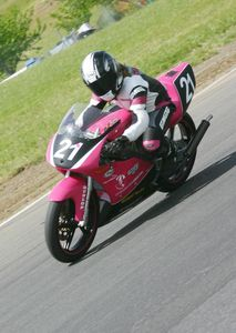 Elena Myers showing nice form and poise on her 1997 Honda RS125 GP racer.
