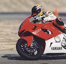 "Editor-in-Chief Plummer went fastest at the racetrack on the YZF: ""The YZF's excellent binders allow you to one-finger the front brakes and the torquey motor produces killer drives off corners."""