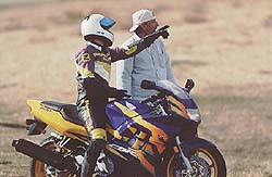 "Editor-in-Chief Plummer (on the CBR600) queries Managing Editor Fortune: ""Where's the first turn, and what's the lap record?"""