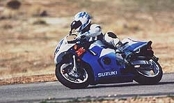 The Suzuki's radical riding position starts to make sense at the track. On the street? It's painful.