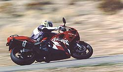 "Shawn Higbee gets down to business on the Kawasaki at Willow Springs: ""To keep up with Graves when he was cruising on the Suzuki,"" Higbee tells us, ""I had to ride the wheels off the Kawasaki, power-sliding it out of turns."""
