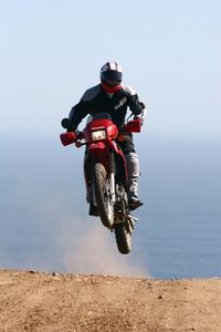 Sean swears that the KLR has impeccable landing manners for a big soft 1980's design... we'll take his word for it.