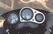 Instrumentation remains racer-esque with a speedo separate from tach and temp gauges.