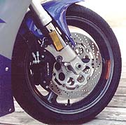 Upside-down forks and six-piston brakes combined to make the GSXR our most stable and hardest stopping racetrack weapon.